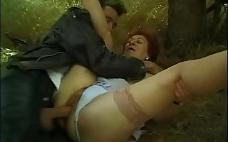A mature woman picks up a chum forcing him to fuck her hairy pussy