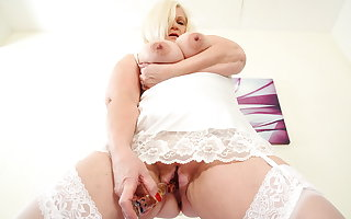 British gilf Lacey Starr fucks her loafer with a dildo