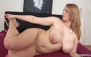 Busty young Tiana roger a large dildo